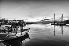Puerto pesquero al atardecer bn (Joaquín Mª Crespo) Tags: byn blackwhite bw blancoynegro harbour twilight quietness seascape fishingboats monocromo marbella winter nikon