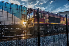 A glimpse of light (Peter Leigh50) Tags: ews db cargo shed fence class 66 biomass drax sky sun fujifilm fuji xt2