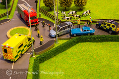 Emergency Response 2 (Steve Purnell Photography) Tags: accident police fire ambulance littlepeople fields trees buildings cows hedges abstract policeservice firebrigade ambulanceservice policemen firemen paramedics policevehicle fireengine people cars rta roadtrafficaccident roundabout roads fences grass