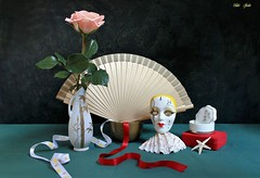 New-Year Thoughts (Esther Spektor - Thanks for 12+millions views..) Tags: stilllife naturemorte bodegon naturezamorta stilleben naturamorta composition creativephotography art tabletop flower rose fan vase mask box lid bowl ribbon star shell ceramics metal pattern white red green golden beige pink black estherspektor canon
