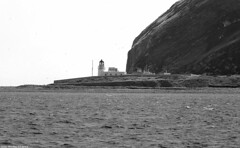 Scotland West Coast the lighthouse and rugged cliffs of the seabird breeding island of Ailsa Craig 1 July 2018 by Anne MacKay (Anne MacKay images of interest & wonder) Tags: scotland west coast sea beach lighthouse rugged cliffs seabird breeding island ailsa craig monochrome blackandwhite mountain landscape 1 july 2018 picture by anne mackay