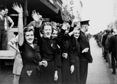Group of shop assistants watching the RAAF parade in Queen Street Brisbane, August 1940 (State Library of Queensland, Australia) Tags: queensland statelibraryofqueensland audience watching parades marches shopassistants worldwar2 1940sfashion police recruits raaf