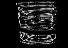 Coils (TejaO) Tags: bw blackandwhite bokeh coiled edisonlamp electric filament glass impressionist lights lightplay lightbulb macro reflection seattlelightiing