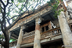 Once a Home... (shamahzoha) Tags: building architecture old ancient archaic vintage beauty trees ruins aged weared pillars design designed shapes pattern beautiful vibrant colorful bricks woven branches green day daylight naturallights streetphotography dhaka bangladesh city oldcity