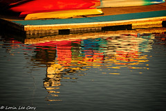Reflection of Boats (lorinleecary) Tags: dock marina reflection red harbor water boats yellow estuary morrobay