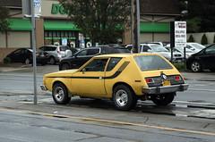 1974 or 1975 AMC Gremlin X (vetaturfumare - thanks for 3 MILLION views!!!) Tags: amc gremlin x 1974 1975 malaise stripes yellow rain dollartree ny newyork longisland americanmotors