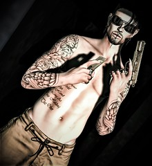 Lone gun man (Paulus Woller) Tags: endlesspaintattoos tattoos tattoo gun man gunman secondlife 9mm catwaheaddudev32 ro