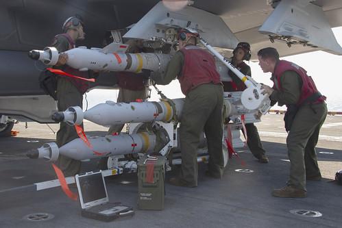 Marines load a guided bomb unit 49 onto an F-35B Lightning II.