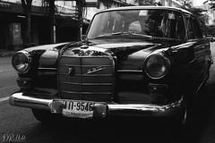 Mercedes-Benz (D. R. Hill Photography) Tags: thailand bangkok asia southeastasia car automobile mercedes mercedesbenz merc benz vintage classic transport street streetphotography mercedesbenz230 mercedesbenz200d film grain analog analogue 135 35mmfilm contax contaxg1 g1 carlzeissplanar45mmf2 zeiss planar 45mm primelens fixedfocallength jch jchstreetpan400 streetpan blackandwhite monochrome japancamerahunter