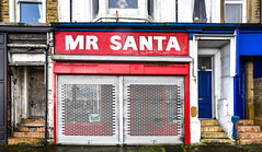 Mr Santa has shut up shop (robmcrorie) Tags: santa claus father christmas shop front morecambe boarded shuttered closed january nikon d850 marine parade