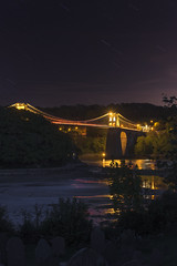 Night Crossing (John Joslin) Tags: dusk night stars water sky uk england menai straits bridge longexposure river graveyard gravestones anglesey wales suspension architecture lights reflections