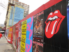 Iron Maiden with Rolling Stones Lips and Tongue Posters 5259 (Brechtbug) Tags: iron maiden concert poster blue construction fence eddie devil monster zombie album british heavy metal skeletal sidekick west 45th street nyc 2018 november 11182018 brit soldier creepy demon dude union jack flag torn billboard posters billboards cover art