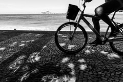 Pedaling in Rio de Janeiro (Luiz Contreira) Tags: riodejaneiro rio beach praia mar ocean bike bicicleta shadows sombras silhouettes blackwhite brazilianphotographer bw brazil brasil southamerica américadosul
