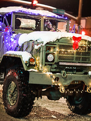 Truck Covered In Snow (wyojones) Tags: wyoming cody christmasparade sheridanavenue snow cold truck lights christmasseason parade man driver tires military wyojones