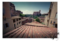 Hope of distance (orichier) Tags: italy siena tuscany city cityscape roof tiles color film sky church