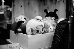 Street photography at night (KaeriRin) Tags: japan japanese street streets streetphotography photography black white blackwhite highcontrast dark no flash noflash lowlight shopping shotengai 書店 商店街 白黒 alpha sony a7m2 a7ii sony7m2 voigtlander voigtlander40mm14mc 40mm 40mm14mc