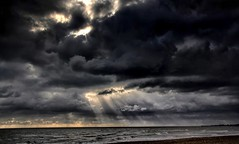 Breaking through (johnlauper) Tags: clouds sea seashore ray sunbeam overcast beach pevenseybay eastsussex