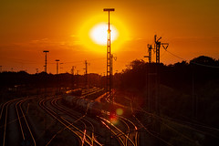Golden Hour (MAKER Photography) Tags: canon eos 7d sunset sun down orange golden hour clouds sky cloud train lens flare cables cable trees leaves leaf tree rails rail