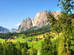 The gentle foothills of the Dolomites (Digidoc2) Tags: valley mountain hills peaks scenery rural scenic landscape countryside trees pasture sky clouds alpine green towns farmland italy dolomites