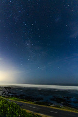 Light spill and the Galaxy (Arranion) Tags: galaxy canon 7d wide angle 10mm long exposure stars water ocean coast
