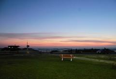 bench (leandropelle) Tags: sunrise dawn colors beach grass colours bench park sea water fotografia brasil