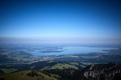The 'Bavarian Sea' (iamunclefester) Tags: hiking trekking kampenwand mountain mountains mountaintop summit top outlook lookout look bella vista chiemsee haze blue sky mist misty herreninsel fraueninsel krautinsel forest green meadows