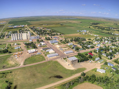 Kennebec is a Small Ranching and Farming Town in Western South Dakota (JacobBoomsma) Tags: southdakota grainelevator spring town green country crops usa plant sunny horizon elevator bin south street smalltown midwest countryside dakota lake rural smalltownamerica morning field panorama buildings aerial america grain foodproduction businesses village summer grainbin willow agricultural greatplains plain agriculture corn drone community smalltownusa panoramic farm west river ranching kennebec