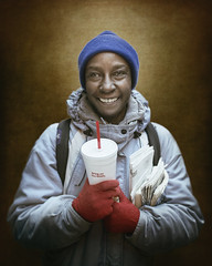 Stacie (mckenziemedia) Tags: homeless homelessness woman beauty beautiful portrait portraiture cup gloves coat backpack hood hat stockingcap chicago urban street city streetphotography