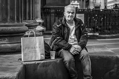 Time Out (Leanne Boulton (Catching Up)) Tags: urban street candid portrait portraiture streetphotography candidstreetphotography candidportrait streetportrait streetlife old elderly man male face eyes expression mood feeling emotion sitting shopping juxtaposition tone texture detail depthoffield bokeh naturallight outdoor light shade city scene human life living humanity society culture lifestyle people canon canon5dmkiii 70mm ef2470mmf28liiusm black white blackwhite bw mono blackandwhite monochrome glasgow scotland uk