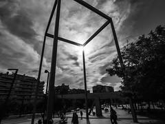 Lesseps square (muntsa-joan-BW) Tags: blackandwhite bw bnw barcelona city catalonia ciudad calle clouds street streetphoto streetphotography monochrome monocromo olympus light structure