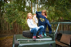 Kids at Wellington Zoo 53 (ArdieBeaPhotography) Tags: preteen toddler preschooler girl boy children young little blonde wild hair play embrace hold cuddle two together friends siblings sister brother cousins shades sunglasses child teen woman family path walk climb braid jeep drive bonnet steeringwheel sparetire overlarge toobig floppy sleeves sweatshirt jumper swing long aviator