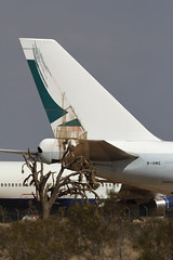 B-HME, Boeing 747-200F, Cathay Pacific Airways, Victorville California (ColinParker777) Tags: bhme boeing 747 b747 747200f b747200f b747200sf 747200sf plane airplane aircraft airliner aviation cathay pacific airways cargo freight freighter airlines airline tail rudder tree jushua stains leak dirt dirty stored storage retired retirement derelict kvcv vcv victorville southern california logistics airport socal desert canon 7d 100400 l lens zoom telephoto pro