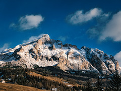 Rocks (Мaistora) Tags: mountain alps dolomites tyrol rocks peak hills trees pine forest village alpinesky clouds sunshine light shadows houses blue green yellow snow winter edit process postprocess lightroom leica dlux typ109 landscape scape color colour