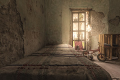 Little kids should never be sent to bed. They always wake up a day older (Marco Bontenbal (Pixanpictures.com)) Tags: nikon d750 tamron 1530 lost abandoned decay decayed urbex urban ue urbanexploring naturallight photography pixanpictures beautiful world hidden bed toys window old bike ball football teddybear pram