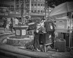 Caught in the Act. (Beegee49) Tags: street boy drink cool box vendor refreshments blackandwhite bw monochrome happyplanet favourites sony a 6000 bacolod city philippines asia downtown child young asiafavorites