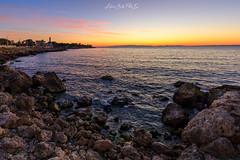 Freddo e colori (Antonio Ciriello PhotoEos) Tags: mare sea seascape seascapes landscapes scogli rocks cliff scogliera colors colours colori sunset sun sole tramonto clouds nuvole sky nature natura puglia apulia italia italy taranto sanvito caposanvito faro lighthouse canon canoneos5dmarkiv 5dmarkiv 5d eos5dmarkiv 1635 1635f4 canon1635 grandangolo wideangle