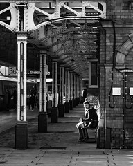 In the spot light (brucewhetton) Tags: waiting station spotlight blackandwhite traveling train street urban