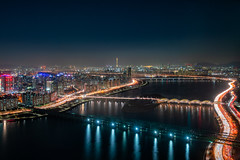 Night view of bridge cross over Han river from Yeouido business district into Lotte World Tower at Seoul City in South Korea (MongkolChuewong) Tags: 63 apartment architecture asia background bridge building business city cityscape daegyo destination detail district downtown famous finance financial freeway han hangang highway illuminated island korea korean landmark landscape light lighttrail metropolis metropolitan modern night olympic residential river road seoul sky skyline skyscraper south sunset tourism travel urban vehicle view yeouido