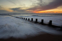 The Morning After (PeskyMesky) Tags: aberdeen aberdeenbeach sunrise sunset beach sand movement water sea ocean landscape red sky cloud canon canon5d eos