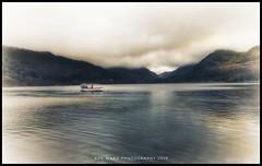Adrift (awardphotography73) Tags: landscape seascape tranquility cymru phototherapy photo mountains snowdonia adrift lakes llanberis water boat wales iphone