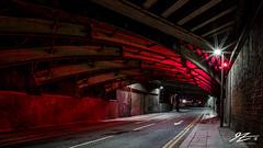 Keep It Light (TVZ Photography) Tags: salford manchester greatermanchester northwestengland streetlight tunnel bridge road red night evening longexposure lowlight sonya7riii zeiss loxia 21mm