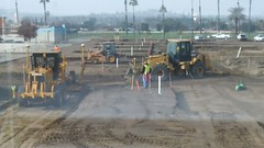 (Rich T. Par) Tags: pomona phillipsranch socal southerncalifornia losangelescounty lacounty constructionsite california palmtrees tree suburb dirt civilengineering sky frontloader heavyequipment grader constructionvehicles tractor road civilengineers parkinglot fence alleyway chainlinkfence firehydrant