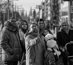 Family Selfie! (captures.in.time) Tags: edinburgh street portrait scotland humansofedinburgh peopleofedinburgh peopleofscotland streetphotography edinburghstreetphotography urban urbanphotography city cityphotography cityscape people peopleoftheworld girl coat candid candidphotography raw canon sigma light evening gloves waves stare family selfie man mum dad
