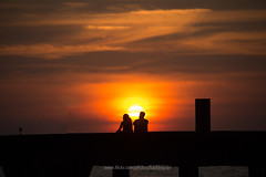 Save to Board Ko Kut (Koh Kood) island - a couple of traveler sitting on the pier seeing sunset. (baddoguy) Tags: architectural column beach beauty in nature bridge built structure close to cloud sky color image concrete copy space couple relationship dating dramatic dusk eternity famous place female likeness frame happiness heterosexual horizontal incidental people island leisure activity looking at view love emotion male outdoor pursuit outdoors photography rear recreational romance romantic scenics sea silhouette sitting sunset thailand togetherness tourism tourist trat province travel destinations two unrecognizable person young