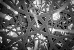 Light Catcher - The Louvre Abu Dhabi - UAE - Leica M10 (Sparks_157) Tags: 50mmf14summilux amit islamicgeometry leica leicam10 louvre louvreabudhabi uae abudhabi amitkar architecture art blackandwhite complex design detail details fineart fineartphotography gallery geometricpattern light monochrome museum rangefinder roof rooftops shadows structure sunbeams sunlight symmetry