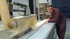 Carpenter cutting plank of wood using circular saw (SawAdvisor) Tags: circular saw woodworking carpenter cutting circularsaw