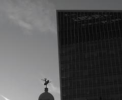 Looming (mesbkr1) Tags: londonstreets clouds sky dancing london urbanphotography blackandwhitephotography blackandwhite bnwphotography bnw photography streetphotography statue architecture building