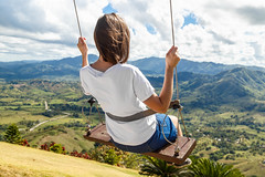 Girl on swing at the clouds in mountain Redonda at Dominican Republic