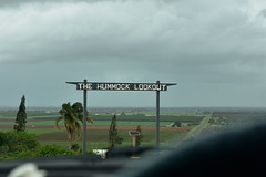 The Hummock (Dreaming of the Sea) Tags: sign clouds rain tamronsp2470mmf28divcusd nikond7200 palmtrees sugarcane hummock macadamiatrees sliderssunday pinetree car bundaberg queensland australia hss