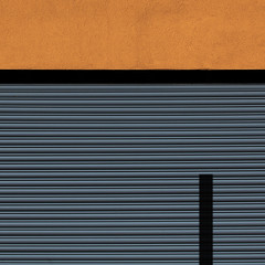 at odds (caeciliametella) Tags: lorrainekerr photography 2018 southshields abstract urban urbano astratto 11 square orange shutters shadow ombra black metal caeciliametella coast neworder